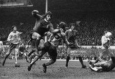 Liverpool football player Kevin Keegan (front, facing camera) leaps past Norwich City player Trevor Howard during a match at Anfield, Liverpool, February 2nd 1974.