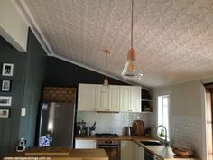 Pressed tin ceilings add a decorative but not over-stated highlight in any room. The Tulip design was used on this ceiling. Pressed Metal, Metal Walls, Ceilings, Tulip, House Ideas, Table, Furniture, Design, Home Decor