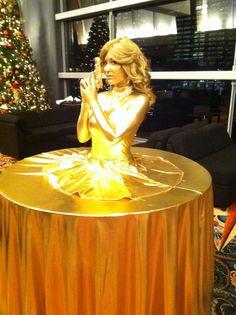 Gold Finger James Bond style strolling table diva by J & D Entertainment Houston, Houston living table, human table, 007