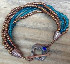 Copper and teal seed bead multi-strand bracelet with toggle clasp