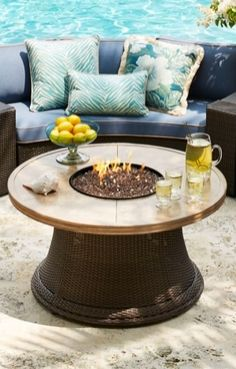 "Friends and family will enjoy spending hours around our beautiful Pasadena Fire Table. The handcrafted porcelain top and all-weather wicker base complement a variety of outdoor collections, and the 44"" wide rim places cocktails and plates of appetizers within easy reach."