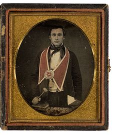 ca. 1850's, [hand tinted daguerreotype portrait of a mason with a gavel]. This image is particularly interesting because it indicates the sash color on this Mason. And isn't his cravat tied interestingly?  via the Historical Indulgences Tumblr via Cowan's Auctions