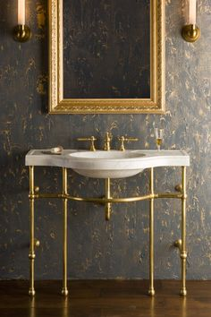 4 Leg Curved Console Shown In Brass With Carrara Marble Sink.