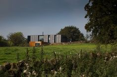 Grillagh Water by Patrick Bradley Architects Grand Designs Uk, Architects Journal, Agricultural Buildings, Water House, Water Containers, Shipping Container Homes, Shipping Containers, Construction, House Built