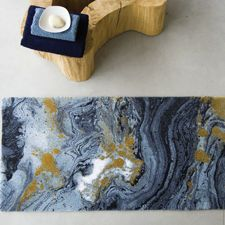 Blue and Gold rug from Abyss Habidecor. Midnight bath rug features a agate stone look with sparkling gold accents.