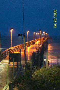 The Surf City fishing pier lit up at night - Surf City, NC (on Topsail Island).