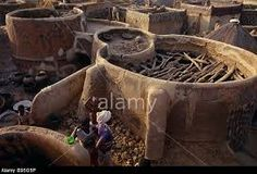 Stock Photo - BURKINA FASO West Africa Tiebele Traditional village of the Gourounsi people with round houses built from unfired mud and timber Desert Area, Round House, West Africa, Building A House, Stock Photos, Traditional, Houses, Outdoor Decor, Crafts
