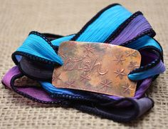 Wish silk wrap bracelet etched on copper. $26, via Etsy: IF Only Pretty