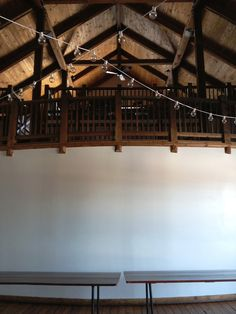 Looking up to the balcony and loft from the main floor. The curved white wall can be decorated in many ways, following the Barn's restrictions. Visit the Wall Decorations - Byron Colby Barn board for inspiration!
