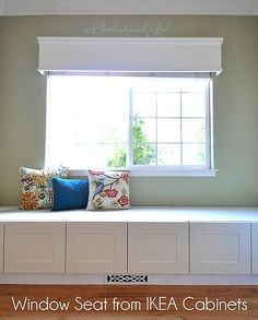 @Mindi Mitchell Low storage cabinets make great window seats, install them cleverly and they look built in. Photo: centsationalgirl.com.