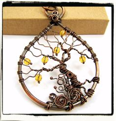 This beautiful handcrafted Tree of Life is made with gently wrapped pure copper wire on a copper frame. Ive woven yellow faceted topaz gemstones onto