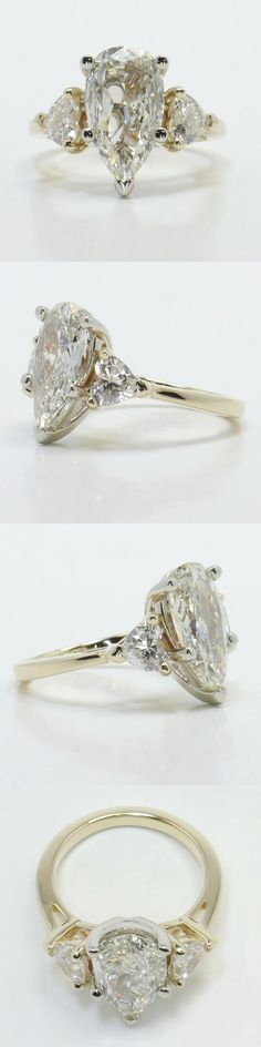 One Pear and Two Hearts Diamond Engagement Ring! Diamond/Gem Cost: $7,962 (Pear 2.35 Ctw. Color: L Clarity: VS1 Cut: Good Certification: GIA Polish: Good) Setting Cost: $1,850 (Metal: 14K White Gold Side Shape: Heart Side Carat: .73 Side Color: G-H Side Clarity: SI1-SI2 Side Cut: Exellent Setting Type: Prong) www.brilliance.com