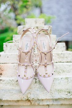 Let your inner rockstar shine in these rock-studded ankle strap heels in light pink from Valentino. If you can squeeze these into your budget then check out the studded heels here. Also, don't miss the inspiration to be had from the rest of this dream come true wedding. PC: Claire Morgan
