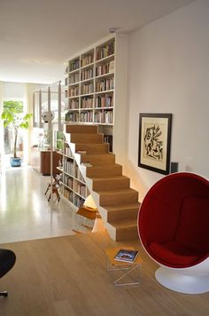 Wraparound staircase and balcony on library bookcase wall | Canal House HG by Powerhouse Architects