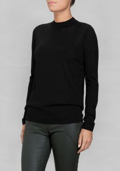 Extending slightly up the neck, mock turtleneck is a sophisticated alternative to the classic more covering style. Made from soft and lightweight merino wool, this sweater has a semi-opaque quality and regular fit.
