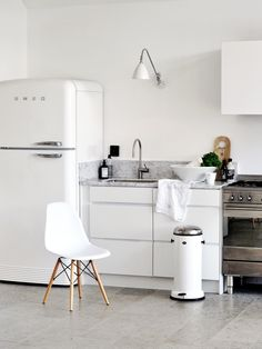 Timeless scandinavian style kitchen. Beautiful grey limestone flooring and marble work surfaces can be found at Mandarin Stone.