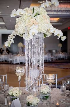 Wedding decoration has umpteen choices and tall centerpieces are one of the extravagant and spectacular décor that one can think of. Flowers are one of the most common things that never run out of … White Flower Centerpieces, Unique Centerpieces, Centerpiece Wedding, Bling Centerpiece, Crystal Centerpieces, Centrepieces, Chandelier Centerpiece, Chandelier Wedding, Centerpiece Ideas