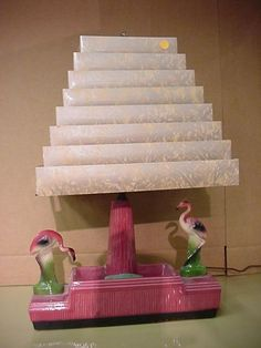Wow, I would not mind finding this one! I've seen several lamps with stepped plastic shades, but they are usually either in horrible condition, or the subject is too kitschy. But flamingoes? Sure!