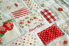 small red prints, stripes, florals, polkadots, sashed in narrow skinny white strips patchwork