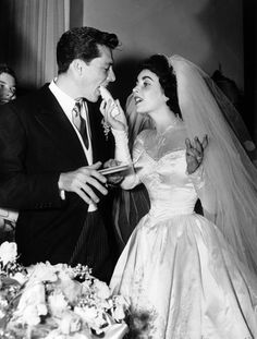 The Elizabeth Taylor/Nicky Hilton wedding gown was recently auctioned for $188,000. Taylor did not own it - MGM did and it was sold at the 1970 MGM auction to a private party.
