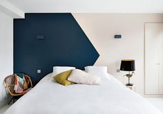 """Rock a Colorblock Want to heighten the drama in an architecturally blah room without breaking out the power tools? Colorblocking walls with contrasting paint tones can do just that—as seen at the Hotel Henriette in Paris (pictured above), where designer Vanessa Scoffier created a focal point and a faux headboard by painting a champion of a navy chevron on an otherwise inconsequential white wall. """"The color stands out so much,"""" said Ms. Bliss, """"you don't even notice the simplicity of the…"""