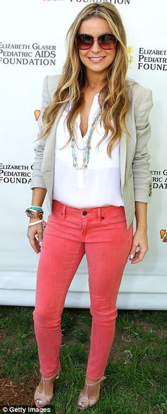 Stylish star: Carmen Electra sported coral skinny jeans with a white blouse and stone-coloured blazer