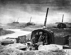A battery of British 114-mm anti-aircraft guns (QF 4.5 inch L/45 Mark II) point skyward in the surrounding area of London, in anticipation for oncoming German bombers.