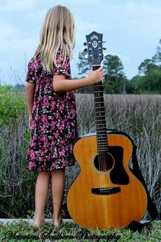 A young girl and a guitar. #music #musicalyouth #kids http://www.pinterest.com/TheHitman14/musical-youth-%2B/