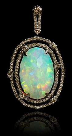 Annoushka Ethiopian opal pendant with a 8.37 carat opal set in white gold and black rhodium with 0.89 carats of champagne diamonds.