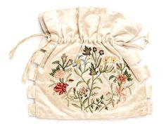 Side one: Embroidered bag, by Mrs. James Burges, c. 1795. The maker was probably Mary Margaret Dennis (born 1779) who married James Burges in 1799. Each side of the bag has delightful floral embroidery in silk thread.