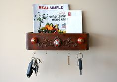 mail sorter and key rack: vintage sewing drawer w. red decorative knobs, via Etsy. (I would change the door pulls into Skelton keys sawed in half as the thing to hang your keys from or as decoration. Just a DIY tip if you like this but want it a bit more toughery/steam punky. But that is just my opinion bc it is a cute mail holder!✌™)
