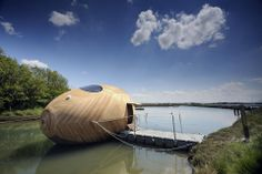 An egg-shaped laboratory designed by Pad Studio, SPUD group and artist Stephen Turner floats on the river beaulieu in the UK.