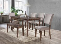 Invite family and friends over to have a meal on this stunning dinette set. Finished with antique natural oak, the dining table is well built with sturdy legs and can seat up to 6 people. The side chairs are upholstered in linen blend to give it a firm relaxing pleasure, in addition to champagne colored nail heads on the back. This rustic set adds a cozy feel to any home, your guest and family will love this set.