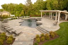 love this pool & patio design with stone steps up to outdoor kitchen | Wheat's Garden & Patio Design