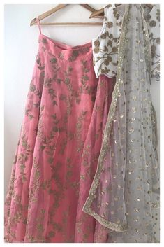 Make a nice hanbok. Featuring a white georgette blouse with dori work all over, the Lehenga skirt is in organza with gota thread embroidery. A white net Dupatta with scattered sequin motifs and sequin and pearl borders completes the look. Indian Lehenga, Red Lehenga, Lehenga Choli, Sabyasachi, Lehenga Skirt, Sarees, Anarkali, Indian Dresses, Indian Outfits