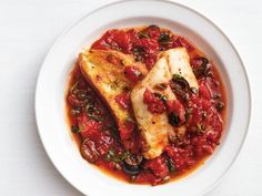 Get Food Network Kitchen's Cod Puttanesca Recipe from Food Network