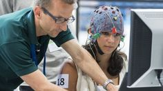 Competitors prepare for a contest involving electronic arms and robotic…