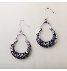 Beautiful dark silver narrow filigree hoop earrings hung from sterling silver hooks. Hypoallergenic. Lead and nickel free. Made by formerly exploited women in East Asia. $17.99