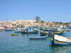 Maltese boats sit calmly in the harbor