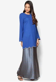 Baju Kurung Modern from Gene Martino in Blue Looking for a modest modern kurung that you can wear for all occasions? Fret not as Gene Martino offers you just that with this minimalist blue piece. Featuring a solid blue shade, it is designed with beige stitch trimmings on the sleeve ends and... #bajukurung #bajukurungmoden