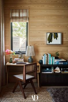 A corner office in the lounge, appointed with a Pierre Jeanneret desk and chair from 1957, isn't roomy enough to handle large work projects, but that's by design—Hale Huna is a remote retreat after all, meant for the owners to unplug their Silicon Valley wires. #office #homeoffice #desk #chair #pierrejeanneret #design #retreat #books #wood #lamp Poured Concrete Counters, Secret House, Corner Office, Polynesian Art, Rural Retreats, Hall Design, Corrugated Metal, Sofa Upholstery, Architectural Digest