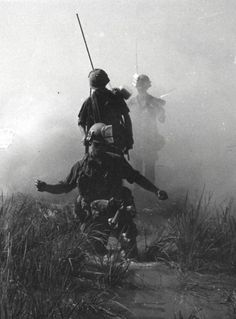 Out of the mist, U.S. Army troops move through a rice paddy south of Saigon, Vietnam ~ Vietnam War