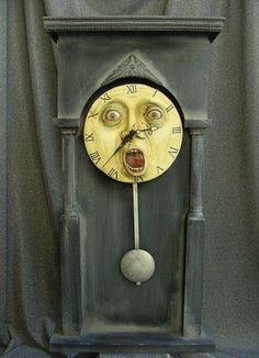 Pendulum  Clock with a moon face & mouth open