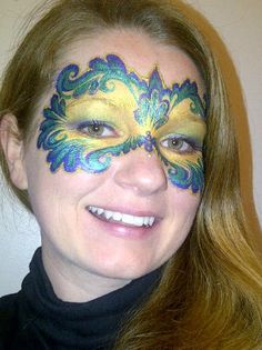 Pretty Mardi Gras/Venetian mask face painting