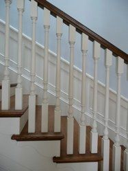 Traditional painted balluster detail, natural wood tread and bannister, painted rise Cozy Basement, Basement Stairs, Basement Ideas, Stairs Colours, Stairs In Living Room, Stair Detail, Garage Remodel, Newel Posts, Wainscoting