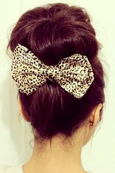 bow underneath big bun ..LOVE this hair color