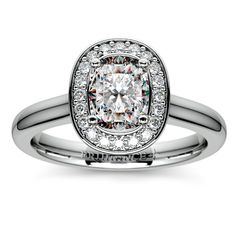 Looking for a simple, sturdy band with a striking center? Check out this elegant stunner from our preset Engagement Ring selection: The Halo Cushion Diamond Ring in Platinum!   http://www.brilliance.com/engagement-rings/halo-diamond-preset-engagement-ring-platinum-1-ctw