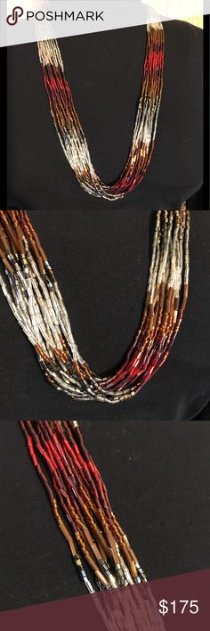 """STUNNING BEADED NECKLACE Beautiful bugle and seed bead necklace.  Fourteen (14) strands of ruby red, silver, gold, black, rust and white glass beads.  Measures 29"""".  Sterling silver cones.  Handmade by me (Split Mountain).  More unique pieces to come, so please follow my closet !  ❤️😻❤️ Split Mountain Jewelry Necklaces"""