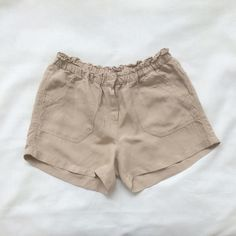 """Forever 21 Shorts Size S Forever 21 size small light beige shorts.   2 front side & 2 back side pockets. Zipper, button & hook/eye closure.   Waist is 26"""" although has elastic & front rise about 10"""" & back rise about 12"""".   55% Linen & 45% Viscose.   Great condition.   If you have questions or wish to see more photos let me know.   Reasonable offers welcomed on all my items.   Thanks for browsing! Forever 21 Shorts"""