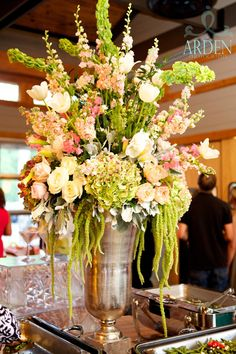The buffet table arrangement at Cypress Inn Pavilion was done in a brushed silver urn.